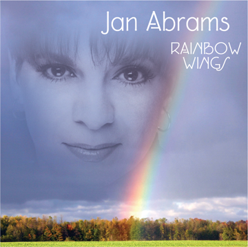 CD cover of ghosted face caressed by rainbow